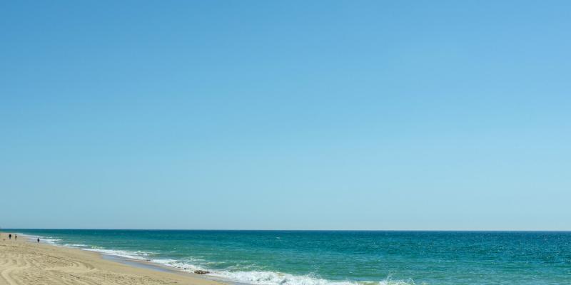 Blue skies, sea and sand at Ancoa Beach, Algarve, Portugal